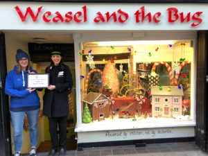 Dressed for Christmas Success: Chester's storefronts are decorated with gingerbread