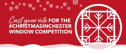 Chester's retailers come together to decorate windows to give the people of the city 'the most festive experience possible' after a troubled year